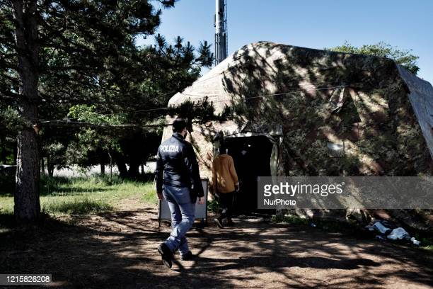 Police man supervised two migrants in the police station of the Italian border town Fernetti after been discovered cross the border between Italy and...