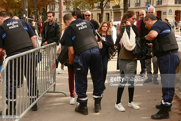 Police manage bag and security checks as tourists and Parisians enjoy the Champs Elysées during the 2016 carfree day organised in Paris across 45% of...