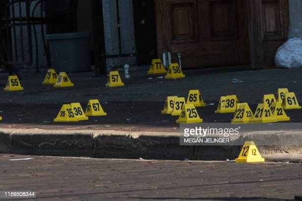 TOPSHOT Police mark evidence after an active shooter opened fire in the Oregon district in Dayton Ohio on August 4 2019 Nine people were killed in a...