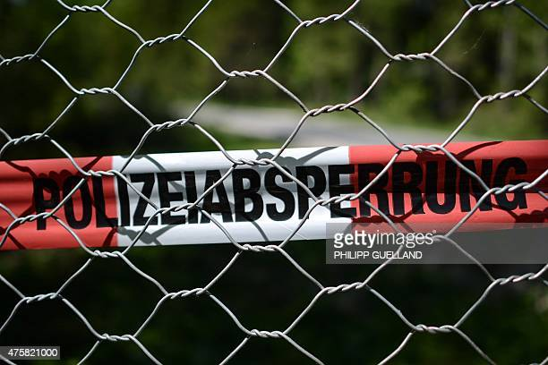 Police marking tape is seen at the perimeter fence that surrounds Elmau castle on June 4, 2015 in Klais near Kruen, southern Germany. Germany will...