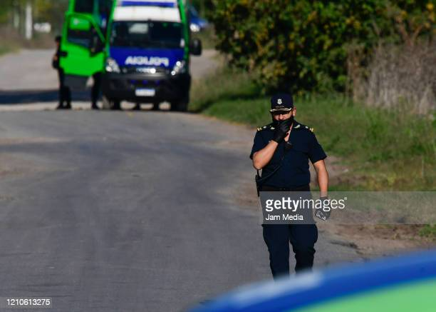 Police member gestures as awaiting progress in negotiations during a mutiny to demand releases and better health care at Melchor Romero state...