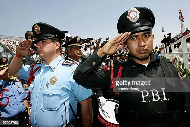 Police members salute during the Mexican National Anthem during the NASCAR Busch Series TelcelMotorola 200 on March 5 2006 at Autodromo Hermanos...