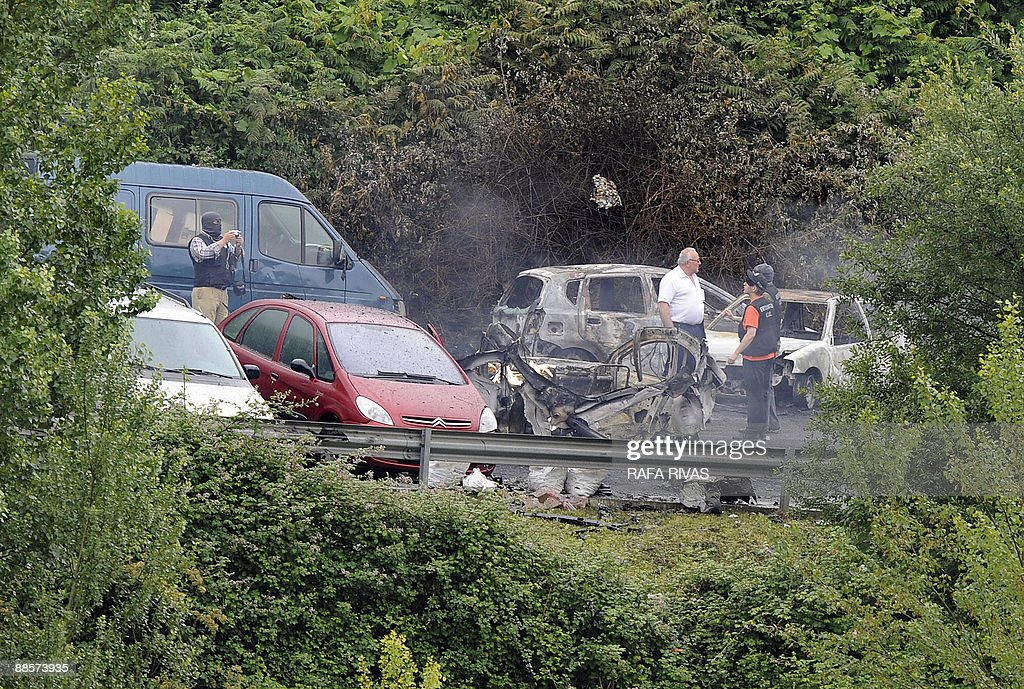 Police Members Work Next To Wreckage Of A Car Owned By Spanish