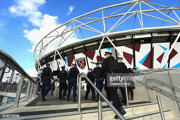 Police men and women make their way into the stadium prior to kick off during the Premier League match between West Ham United and Sunderland at...