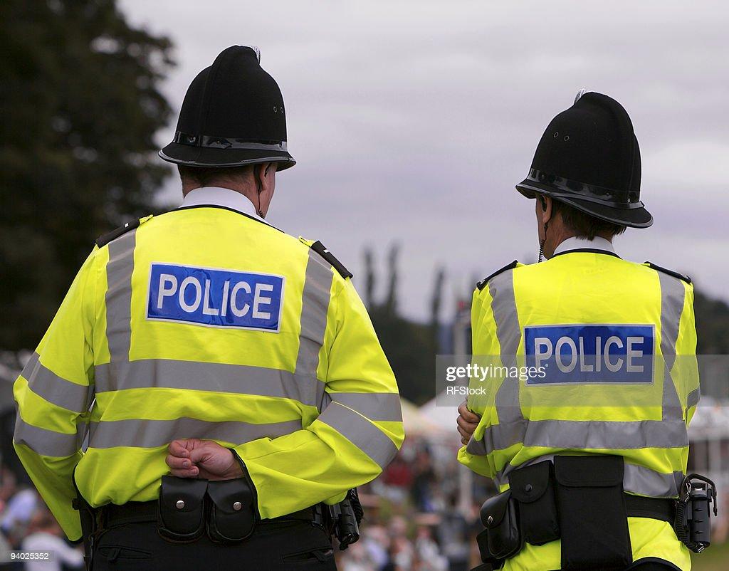 Police men at summer fair showground : Stock Photo