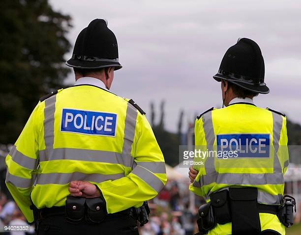 police men at summer fair showground - british culture stock pictures, royalty-free photos & images