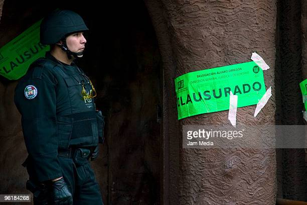 Police men in front of the bar where the Paraguayan player Salvador Cabanas was shot during an attack on January 25 2010 in Mexico City Mexico