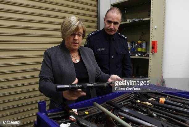 Police minister Lisa Neville and Superintendent Paul Millett look at a bin containing various weapons at the Victoria Police Forensic Services Centre...