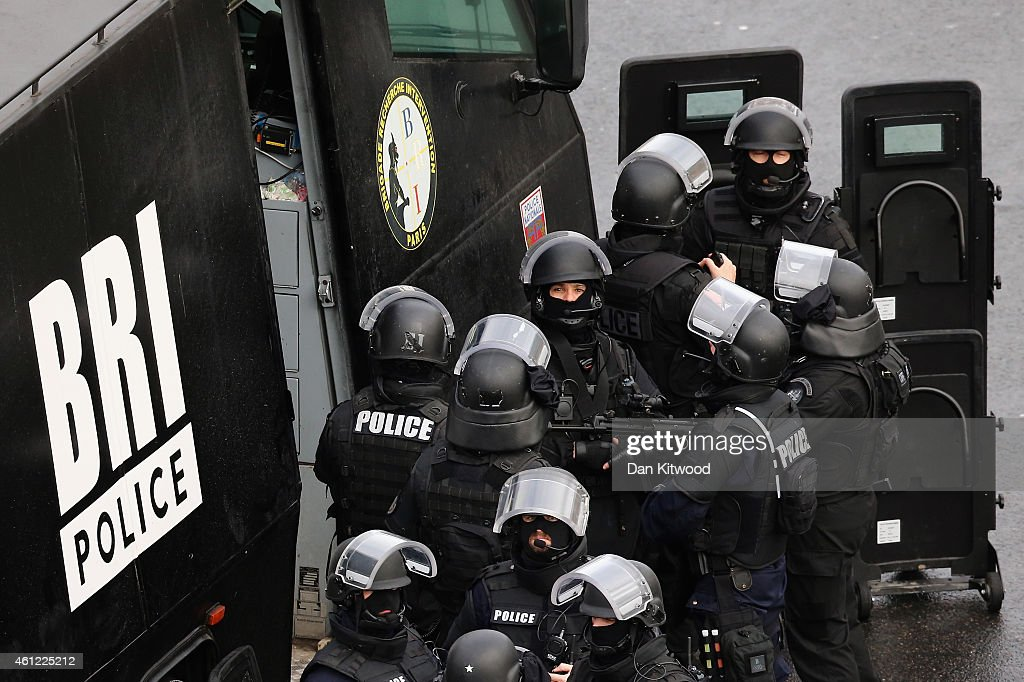 Police mobilize with reports of a hostage situation at Port de Vincennes on January 9, 2015 in Paris, France. According to reports at least five people have been taken hostage in a kosher deli in the Port de Vincennes area of Paris. A huge manhunt for the two suspected gunmen in Wednesday's deadly attack on Charlie Hebdo magazine has entered its third day.