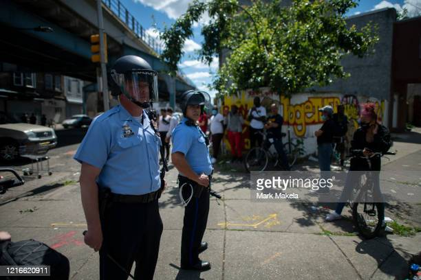 Police monitor activity during widespread unrest following the death of George Floyd on May 31 2020 in Philadelphia Pennsylvania Protests have...
