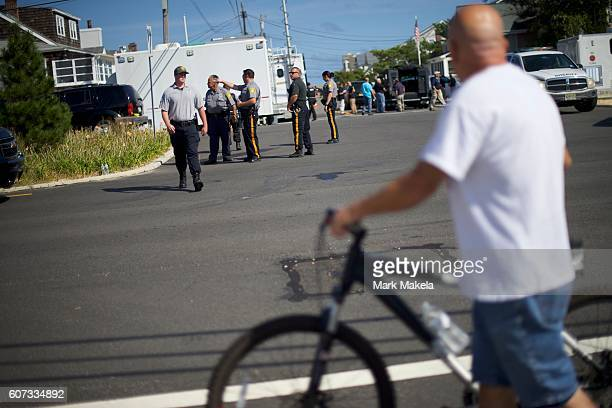 Police monitor activity near the site of the 'pipe bombstyle device' explosion which they heard only four houses away on September 17 2016 in Seaside...