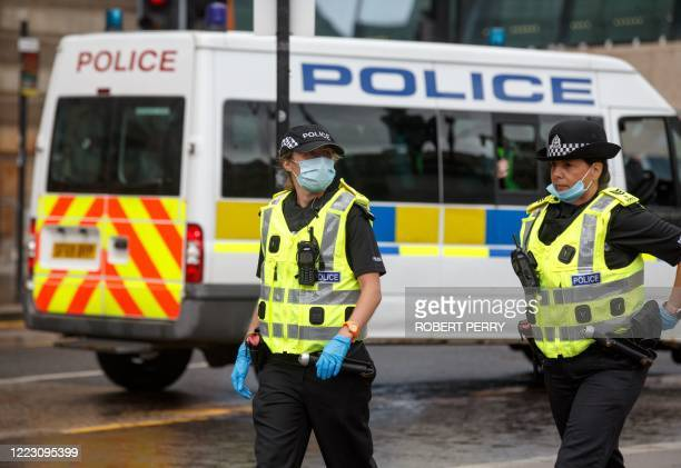 Police monitor in George Square, Glasgow on June 27 after reports that a loyalist demonstration was due take place following a stabbing incident at...