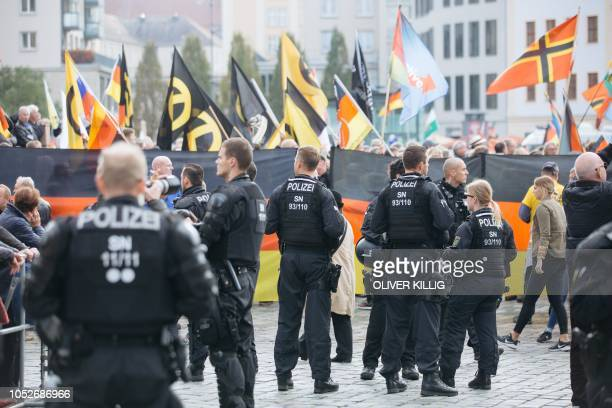 Police monitor supporters of the the antiIslam PEGIDA movement staging a rally marking the movements fouryear anniversary in Dresden eastern Germany...