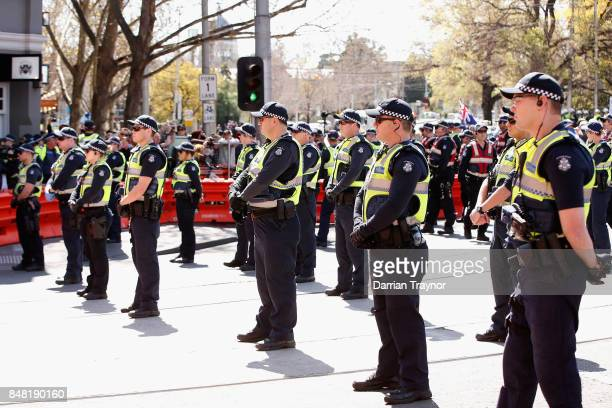 Police monitor the protest on September 17 2017 in Melbourne Australia Leftwing group Campaign Against Racism and Fascism organised a rally to...