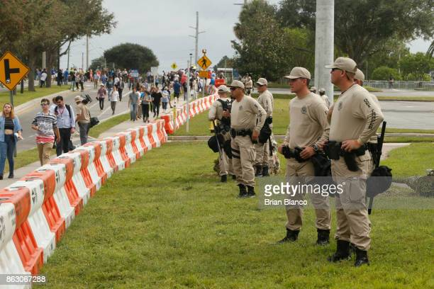 Police monitor the scene at the site of a planned speech by white nationalist Richard Spencer who popularized the term 'altright' at the University...