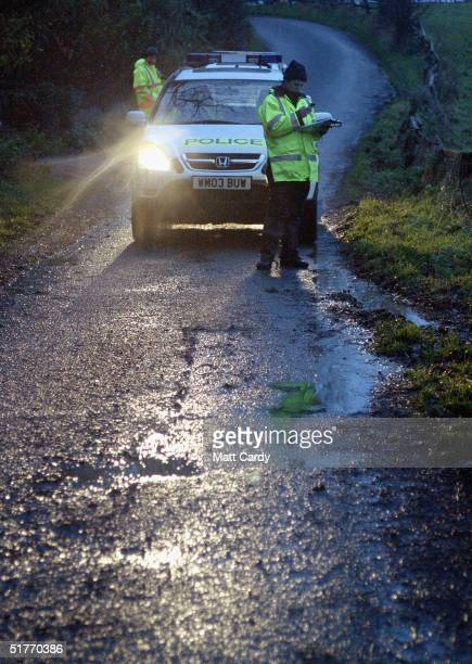 Police monitor the Wessex Hunt Saboteurs as they try to demonstrate against a hunt organised by the Avon Vale Hunt on November 20, 2004 in Wiltshire,...