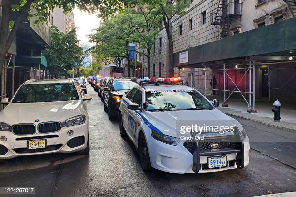 A police motorcade arrives at the makeshift morgue at Lenox Hill Hospital to escort the body of Glen Ridge New Jersey police officer Charles Roberts...