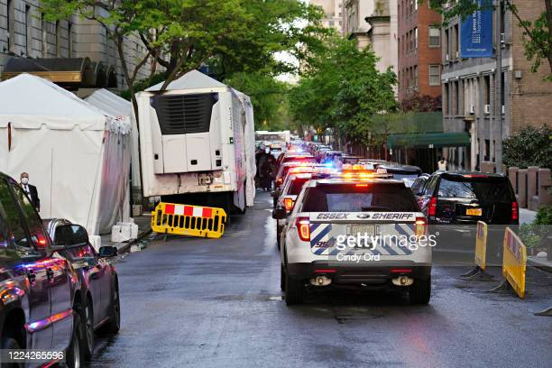 A police motorcade arrives to the makeshift morgue at Lenox Hill Hospital to escort the body of Glen Ridge New Jersey police officer Charles Roberts...