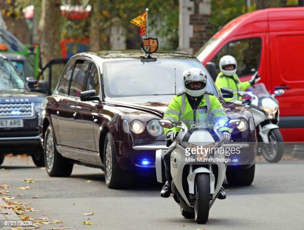 Police motorcycle outriders of the Metropolitan Police Special Escort Group lead Queen Elizabeth II's motorcade as she arrives to reopen the Sir...
