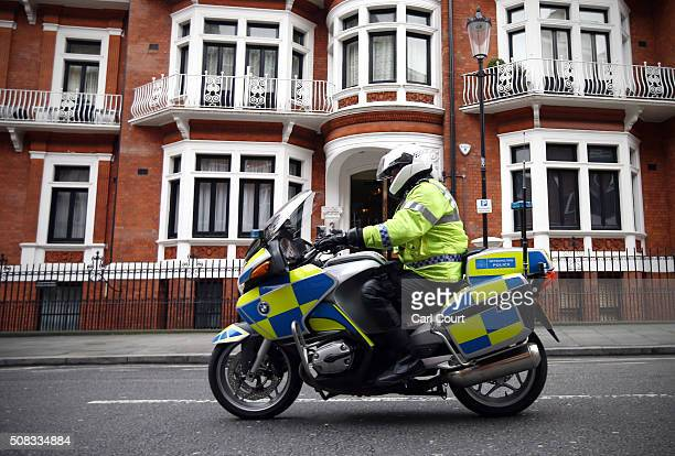 A police motorcycle rides past the Ecuadorian embassy where Wikileaks founder Julian Assange continues to seek asylum following an extradition...
