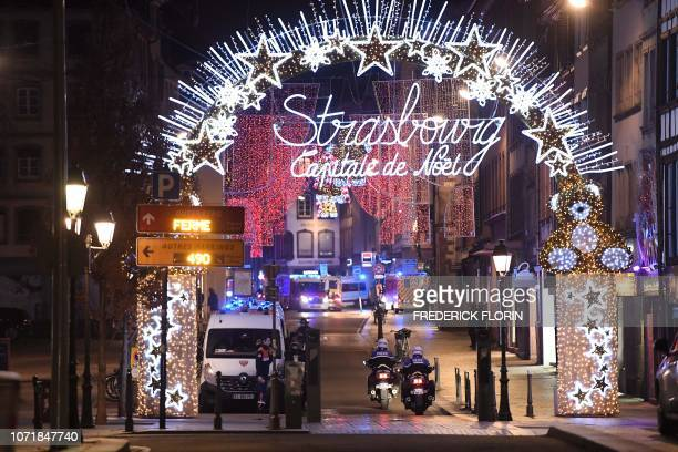 Police motorcycles drives in the streets of Strasbourg eastern France after a shooting breakout on December 11 2018 At least two people have been...