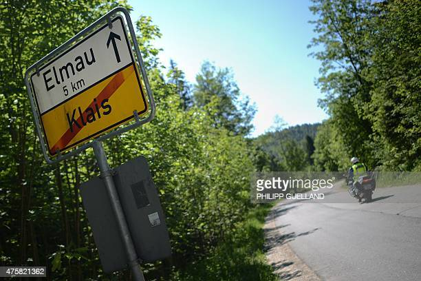 Police motorcyclist passes a sign on the road to Elmau castle during preparation for G7-summit on June 4, 2015 in Klais near Kruen, southern Germany....