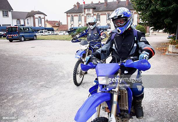 Police motorcyclists arrive for a briefing following the escape of JeanPierre Treiber from the Auxerre prison on September 10 2009 in Joigny France...