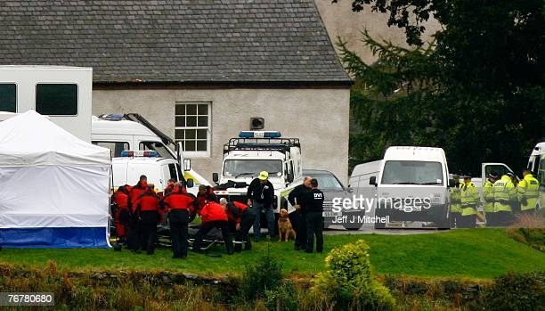 Police mountain rescue remove a body from the scene where a twin squirrel helicopter crashed yesterday September 16 2007 in Lanark Scotland The...