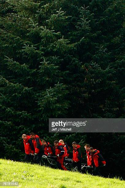 Police mountain rescue remove something from the scene where a twin squirrel helicopter crashed yesterday September 16 2007 in Lanark Scotland The...