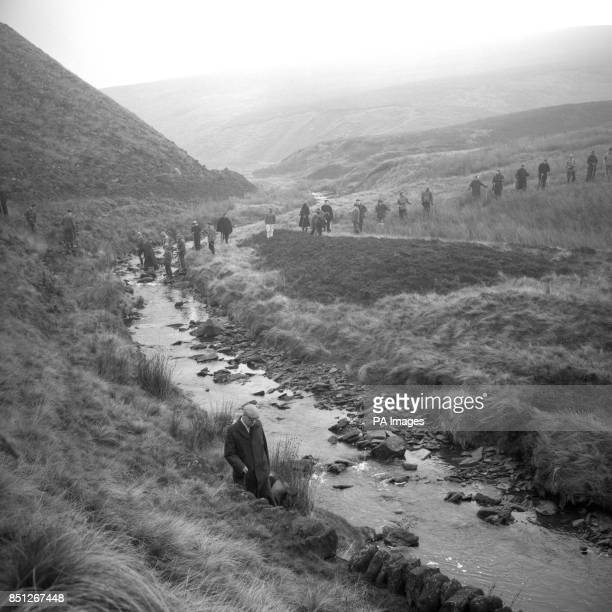 A police mounted search Saddleworth Moor near Woodhead for the bodies of the victims of the Moors Murderers The Moors murders were committed by Ian...