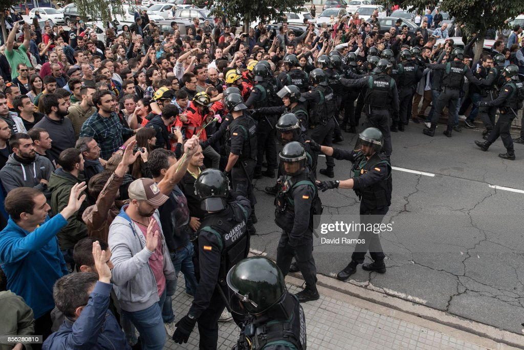 Police move back to their vans followed by members of the public after storming into polling station to confiscate ballot boxes and ballots where the President Carles Puigdemunt will vote later today on October 1, 2017 in Sant Julia de Ramis, Spain. More than five million elegible Catalan voters are estimated to visit 2,315 polling stations today for the Catalonia's referendum on independence from Spain. The Spanish government in Madrid has declared the vote illegal and undemocratic.