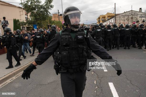 Police move back to their vans followed by members of the public after storming into polling station to confiscate ballot boxes and ballots where the...