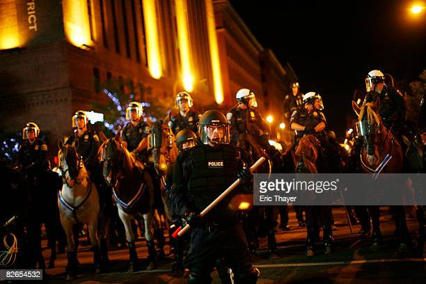Police move in as Rage Against The Machine fans protest after a show outside the Target Center on September 3 2008 in Minneapolis Minnesota The...