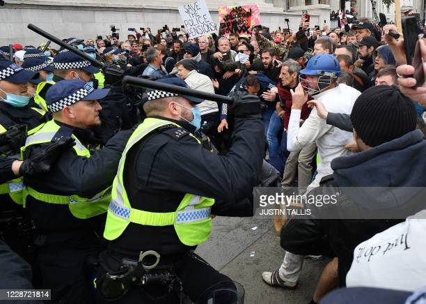 TOPSHOT Police move in to disperse protesters in Trafalgar Square in London on September 26 at a 'We Do Not Consent' mass rally against vaccination...