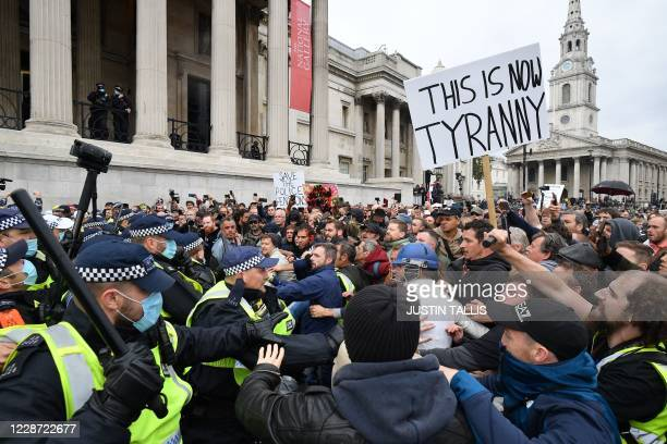 Police move in to disperse protesters in Trafalgar Square in London on September 26 at a 'We Do Not Consent!' mass rally against vaccination and...