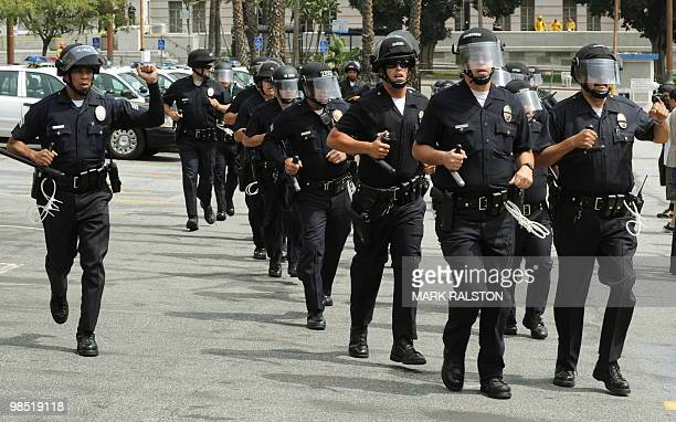 LAPD police move in to protect members of the neonazi group The American National Socialist Movement from an angry crowd of counterprotesters after...