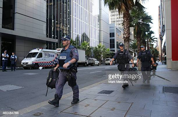 Police move items on Philip St near the Lindt Cafe Martin Place on December 15 2014 in Sydney Australia Police attend a hostage situation at Lindt...
