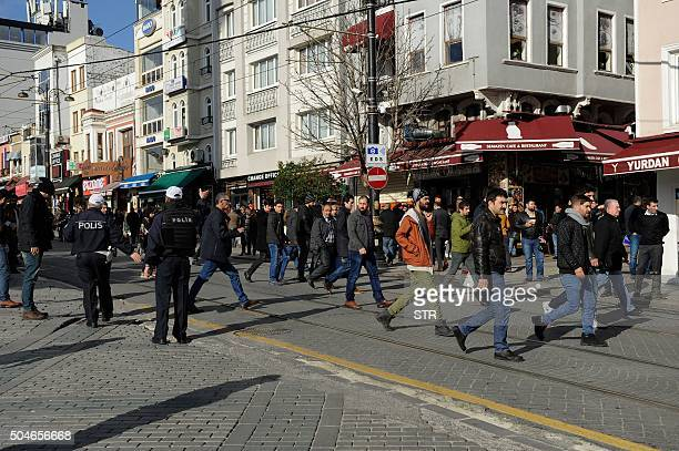 Police move people on as they secure an area at the historic Sultanahmet district of Istanbul on January 12 2016 after an explosion Ten people were...