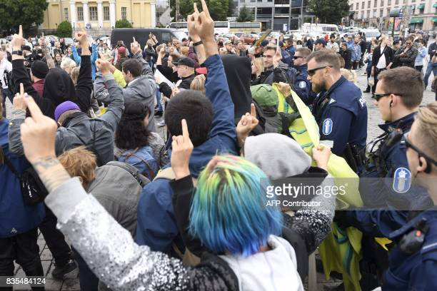Police move the antiracist protesters further from rightwing demonstrators at the Turku Market Square Finland on August 19 2017 Two people were...