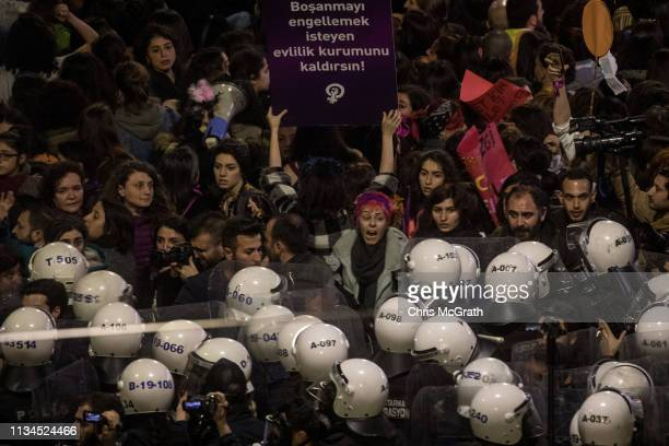 Police move to disperse thousands of people attempting to march down Istanbul's famous Istiklal street during a rally for International Women's Day...