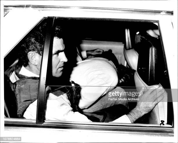 Police nabb the two fugitives, Michael & Garry Murphy after a lighting raid to a block of Townhouse in Tari Way Glenfield. February 27, 1986. .