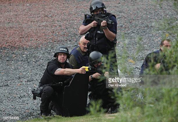 Police negotiate with a man fitting the description of fugitive gunman Raoul Moat on July 9, 2010 in Rothbury, England. Police are negotiating with a...