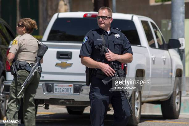Police offers stand guard at North Park Elementary School following a shooting on campus on April 10, 2017 in San Bernardino, California. Two people...