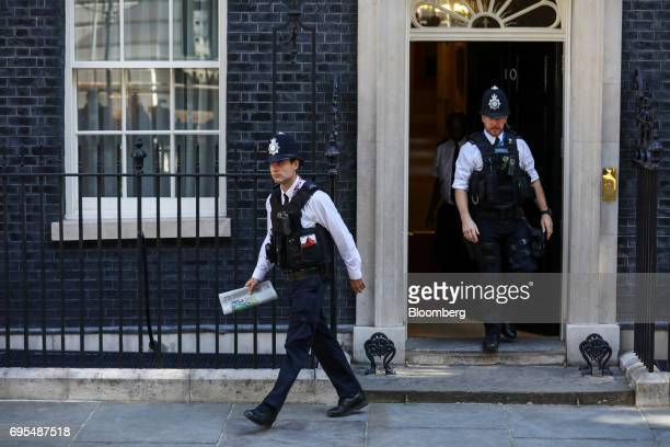 Police offficers leave number 10 Downing Street in London UK on Tuesday June 13 2017 UK Prime MinisterTheresa Maybought herself a stay of execution...