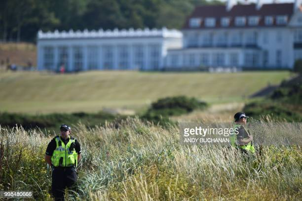 Police offficers stand guard outside Trump Turnberry the luxury golf resort of US President Donald Trump in Turnberry southwest of Glasgow Scotland...