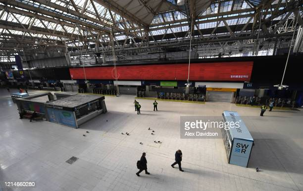 Police Office and National Rail Staff are seen at an empty Waterloo Station on March 25 2020 in London England British Prime Minister Boris Johnson...