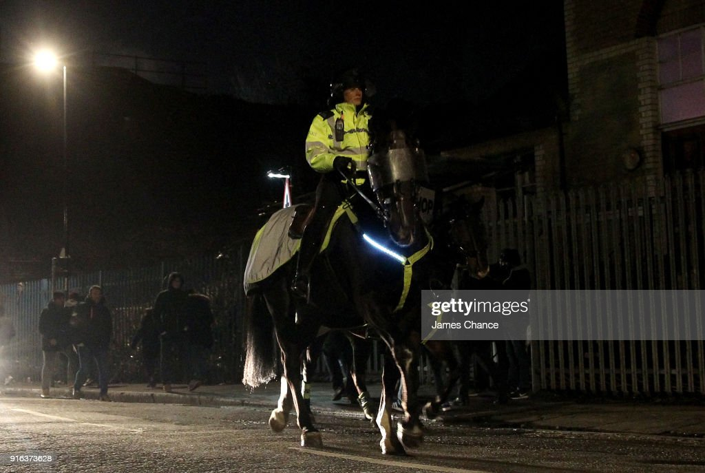 A police office on horseback is seen near the stadium prior to the Sky Bet Championship match between Millwall and Cardiff Cityat The Den on February 9, 2018 in London, England.