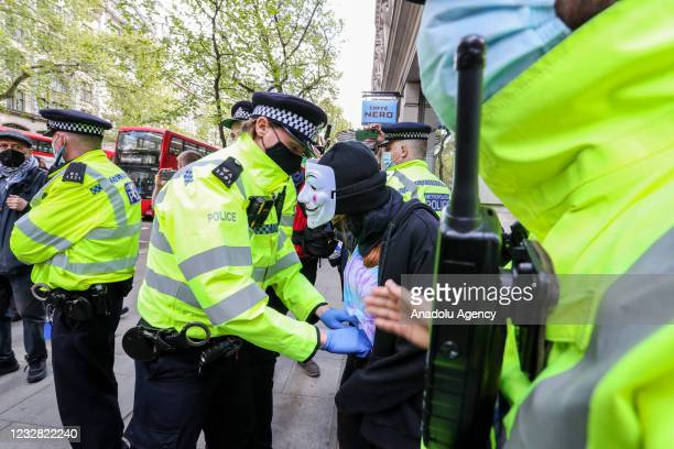 Police office stops and searches one of the pro-Palestinian demonstrator outside Elbit System HQ in London as demonstrators protest against Israeli...