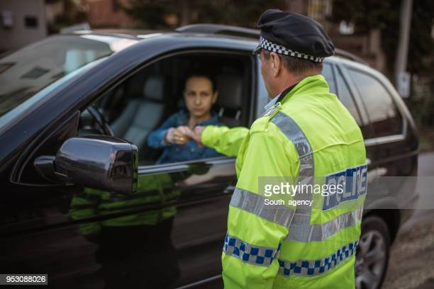 police officee giving ticket - traffic examining stock pictures, royalty-free photos & images