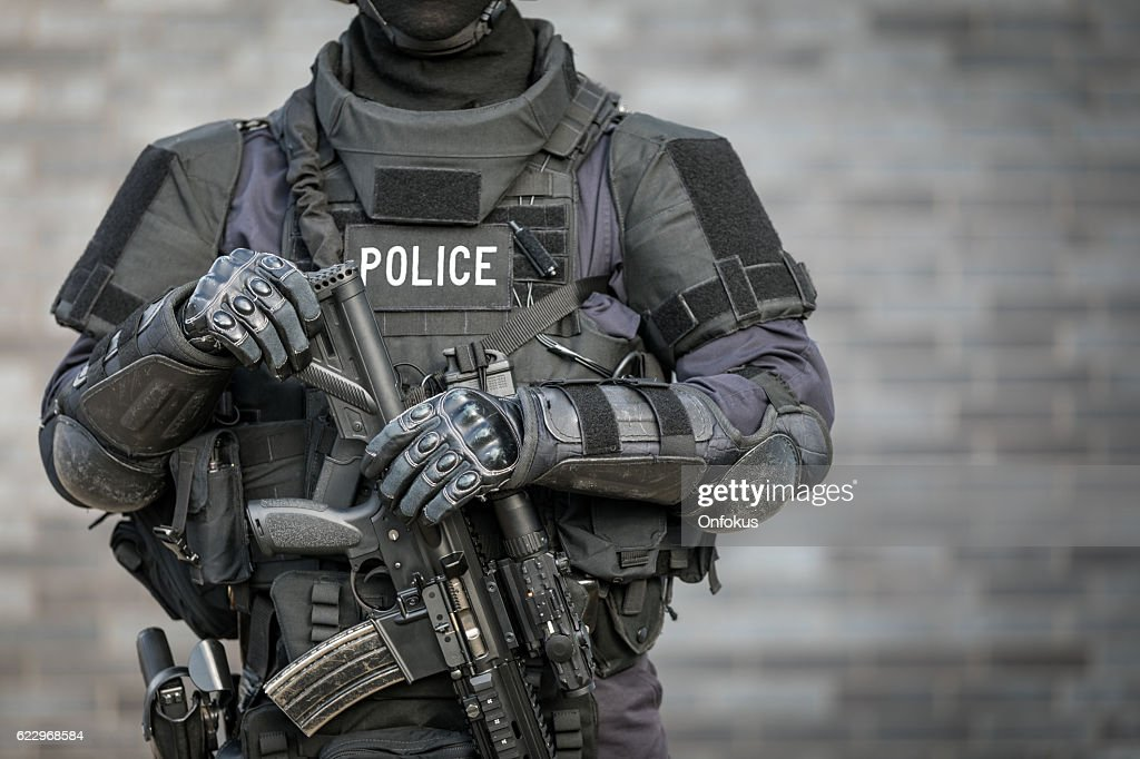 SWAT Police Officer Against Brick Wall : Stock Photo